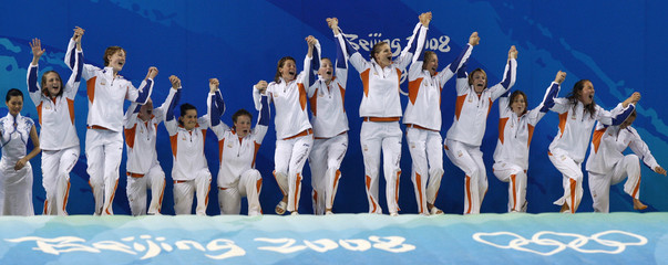Netherlands players step onto the podium to receive their gold medals after their women's water polo gold medal match against the U.S. at the Beijing 2008 Olympic Games