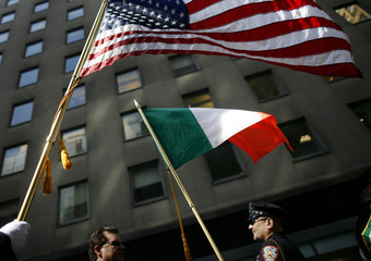 The flags of United States and Ireland are held by New York Department of Correction officers during St. Patrick's Day parade in New York