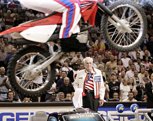 File photo of former motorcycle daredevil Knievel watching person jumps toy cars on dirt bike during timeout of a Suns and Lakers NBA game in Phoenix