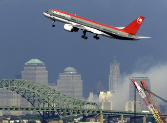 NORTHWEST FLIGHT TAKES OFF OVER NEW YORKS CHANGED SKYLINE.