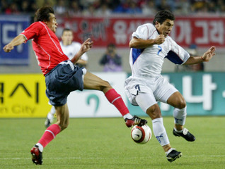 CABANAS FROM PARAGUAY BLOCKS CHOI FROM SOUTH KOREA AT SOCCER MATCH IN INCHON.