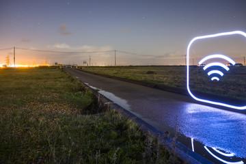 Glowing wifi icon on barren landscape.