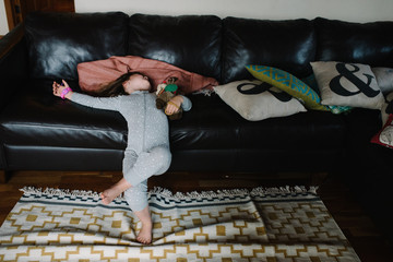 Girl resting against couch
