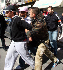 Police officers arrest demonstrators after clashes during a protest against the CPE in Marseille