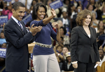 US Senator Barack Obama, his wife Michelle, and Teresa Heinz Kerry greet the crowd at a rally at the Peterson Events Center in Pittsburgh