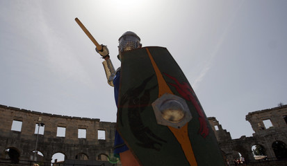A gladiator member of the Hungarian Collegium Gladiatorium fighting club attends practice in the Roman amphitheater during morning training in Pula