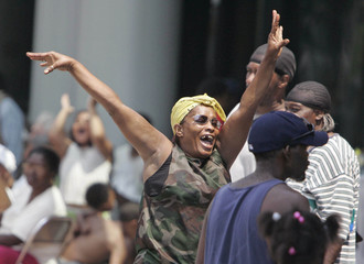 A Hurricane Katrina survivor celebrates the arrival of National Guard troops in New Orleans.