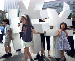 SCHOOLCHILDREN HOLD UP THE YEN SYMBOL DURING DEMONSTRATION IN FRONT OF FINANCE MINISTRY IN TOKYO.