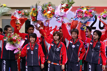 Indonesian team celebrates their second place at Surdiman Cup finals in Beijing.