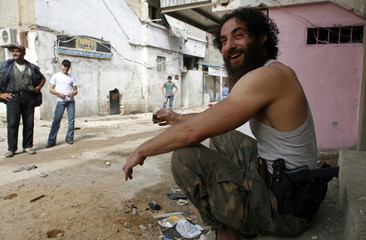 A Palestinian Islamist militant member of Jund al-Sham group smiles in Ain al-Hilweh refugee camp