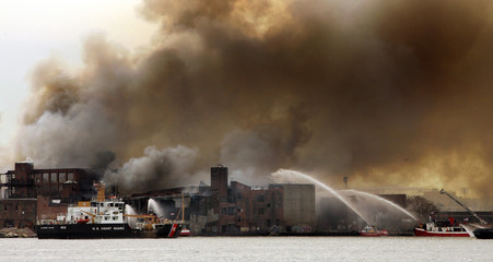 Smoke rises from a fire at a waterfront warehouse in Brooklyn
