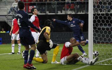 Arsenal's van Persie celebrates after Fabregas scored against AZ Alkmaar during their Champions League soccer match in Alkmaar