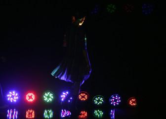 A model displays a creation by Japanese designer Yuko Murata during Japan Fashion Week in Tokyo