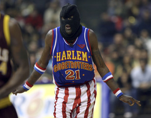Kevin Daley of Harlem Globetrotters wears a balaclava during exhibition game against NY Nationals in Istanbul