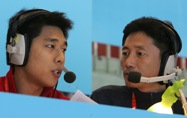 Retired South Korean short track speed skater Kim gives commentary during warm-up before woman's 1500 metres short track speed skating heats at Winter Olympic Games