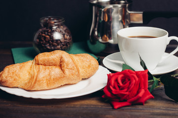 cup of tea, rose, croissant