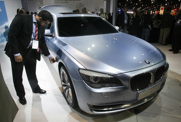 A man examines the BMW Concept 7 Series ActiveHybrid automobile during its U.S. debut at the LA Auto Show
