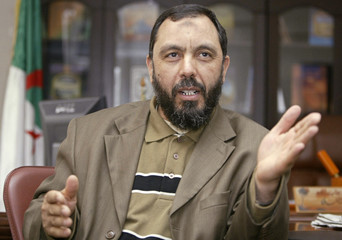 Djaballah, leader of the main opposition Islamist party El-Islah, speaks with reporters in his office in Algiers
