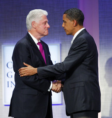 U.S. President Barack Obama shakes hands with former U.S. President Bill Clinton at the Clinton Global Initiative in New York