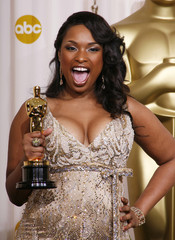 Jennifer Hudson reacts with her Oscar backstage at the 79th Annual Academy Awards in Hollywood