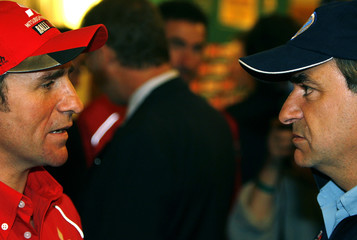 Stephane Peterhansel of France and Carlos Sainz of Spain talk during a news conference in Budapest