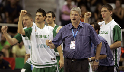 Slovenia's players and coach Pipan celebrate a basket during their first round losing game against Italy at the European Basketball Championships in Alicante