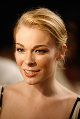 LeAnn Rimes speaks to a reporter backstage before the Heart Truth Red Dress fashion show in New York