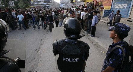 Riot police face Maoists at a demonstration in Kathmandu