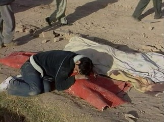 IRANIAN MAN MOURNS OVER THE BODY OF A LOVED ONE FOLLOWING A DEVASTATING QUAKE IN BAM, IRAN.