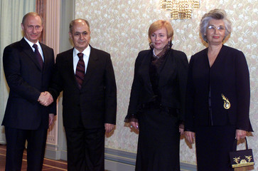 Turkish President Ahmet Necdet Sezer and Russian President Vladimir Putin pose to photographers as ...
