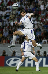 GREECE'S HARISTEAS PREPARES TO HEAD THE BALL TO SCORE GOAL AGAINST FRANCE AS HIS TEAM MATE ...