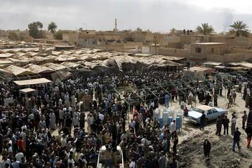 GENERAL VIEW OF MARKET PLACE WHERE CIVILIANS KILLED IN AIR RAID INBAGHDAD.