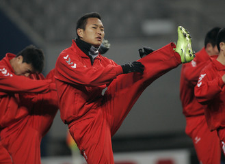 North Korean national soccer team striker Jong warms up during a training session for the FIFA World Cup qualifying soccer match in Seoul