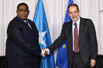 European Union foreign policy chief Solana welcomes Somalia's Prime Minister Ali Sharmarke before their meeting at the EU Council in Brussels