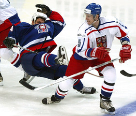 RICHTER OF CZECH REPUBLIC HITS THE ICE AGAINST SLOVENIA.