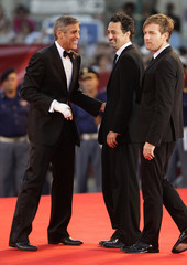 Actors McGregor, Clooney and director Heslov pose for photographers during a red carpet at the 66th Venice Film Festival