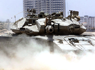 AN ISRAELI TANK DRIVES INTO PALESTINIAN RULED AREA NEAR NETZARIM JEWISHSETTLEMENT IN GAZA.