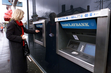 A CUSTOMER USES A CASHPOINT MACHINE IN MANCHESTER.