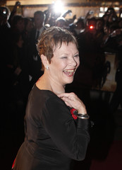 """British actress Dench shows 007 sign on her neck as she arrives for world premiere of James Bond movie """"Quantum of Solace"""" in London"""