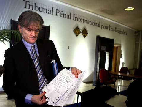 Lawyer of former Yugoslav president Milosevic displays a handwritten letter by Milosevic in The Hague