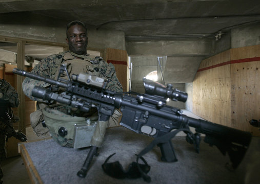 A U.S. marine equipped with MILES takes a rest after he conducted a military operation in Pocheon