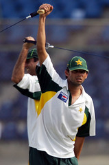 Pakistan's Mohammad Asif stretches during a cricket training session in Karachi