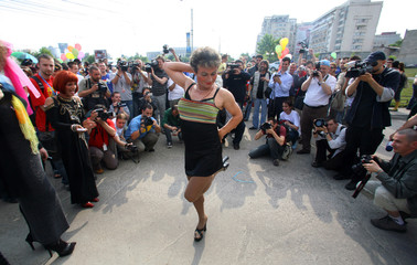 A member of Romania's gay community poses for photographers in Bucharest