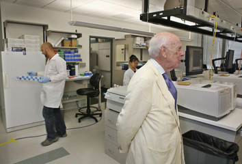 Watson, co-discoverer of the DNA helix and father of the Human Genome Project, stands inside laboratory in Houston
