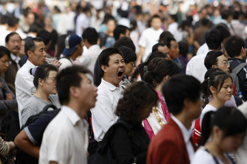 A man yawns at the Beijing railway station
