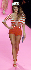 A Playboy Playmate models a sailor outfit with hat at the Betsey Johnson Spring 2001 fashion show in..