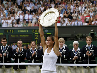 France's Mauresmo holds the trophy aloft after winning the women's final against Belgium's Henin-Hardenne at the Wimbledon tennis championships in London