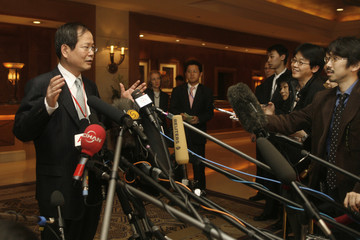South Korean chief negotiator Chun Yung-woo answers a question at a hotel