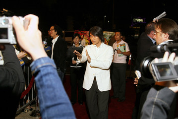"""Hong Kong actor-director Stephen Chow poses during the premiere of """"Kung Fu Hustle"""" in Hollywood."""