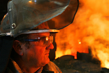Richard Contreras, worker at Arcelor steel plant Cockerill Sambre, looks at furnace in Ougree